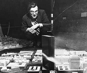 Frank Durgin in the Wright Brothers Wind Tunnel with Hancock Building model.