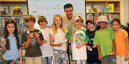 Suarez with students