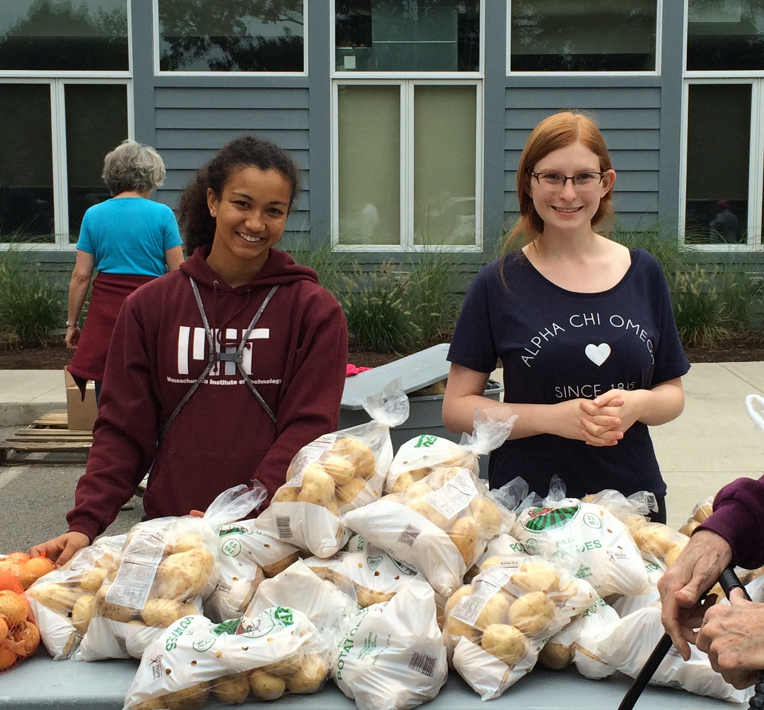 Volunteers distributing donations of potatoes