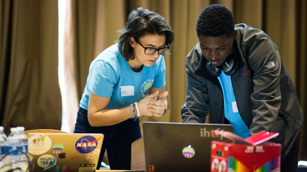two students working together at a computing event