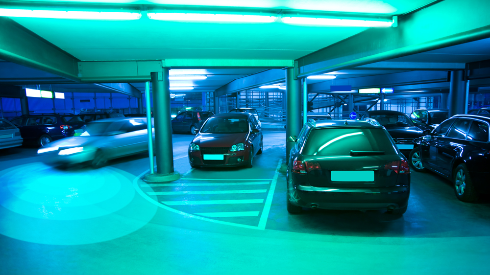 An image of an autonomous car driving in a parking garage