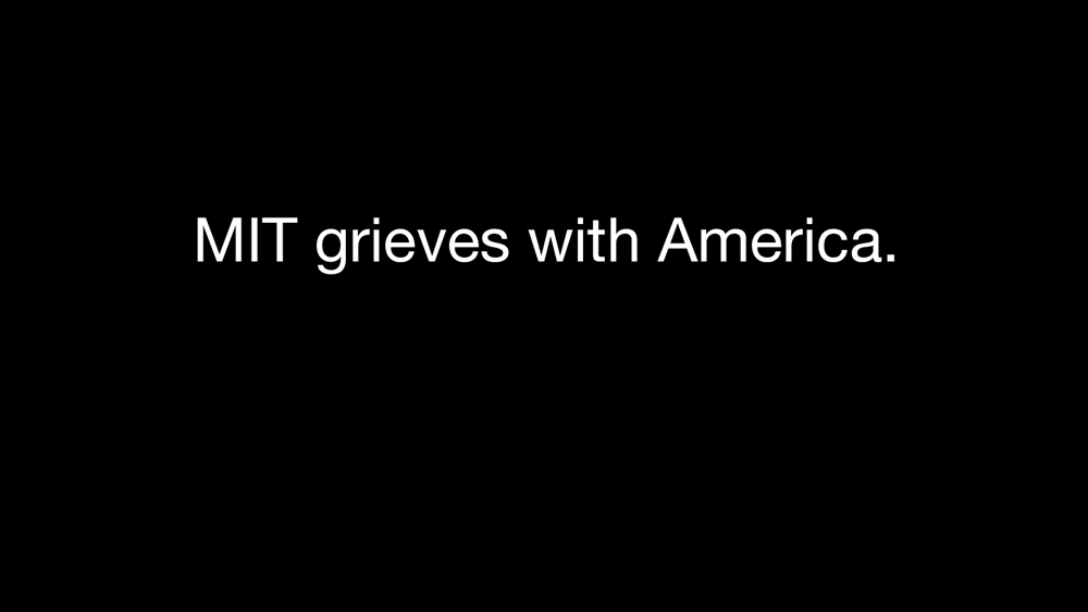a black screen with MIT grieves with American displayed text