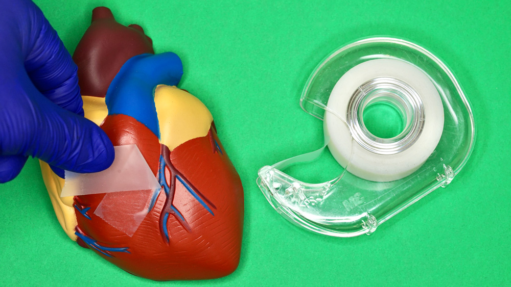 photo of a toy heart with a piece of tape, and a tape holder