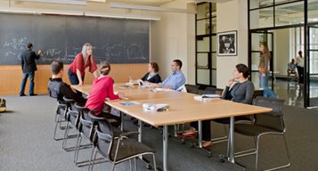Photo of students in the Pappalardo Community Room, one of the many rooms of the Green Center, which will bring together the MIT physics community as a site for collaboration and research.
