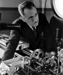 George R. Harrison, pictured here with his 'automatic comparator,' which allowed for the wholesale measurement of spectral wavelengths at much higher speeds than had previously been accomplished.