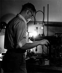 Henry W. Kendall, shown here as a graduate student at MIT experimenting with high intensity microwave excited glow discharge.  Years later he would win, along with Jerome I. Friedman, the 1990 Nobel Prize in Physics.