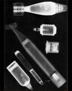 X-rays of captured Japanese munitions taken in Van de Graaff and Buechner's high-voltage laboratory during the war.