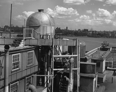 The dome of the Rad Lab's rooftop radar laboratory overlooks the Charles River.