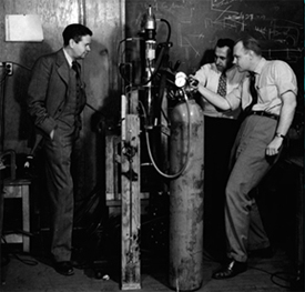 Department Chair John C. Slater (left) watches Associate Professor Melvin A. Herlin (right) and a technician in the low-temperature laboratories of the Research Laboratory of Electronics (RLE), 1949.