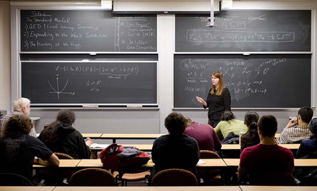 Professor Janet Conrad lecturing in her Introduction to Nuclear & Particle Physics class 8.276.