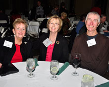 Photo: Kay Arthur, board member Kathy Doyle, and Ray Diffley are all smiles at the 2012 winter holiday gathering.