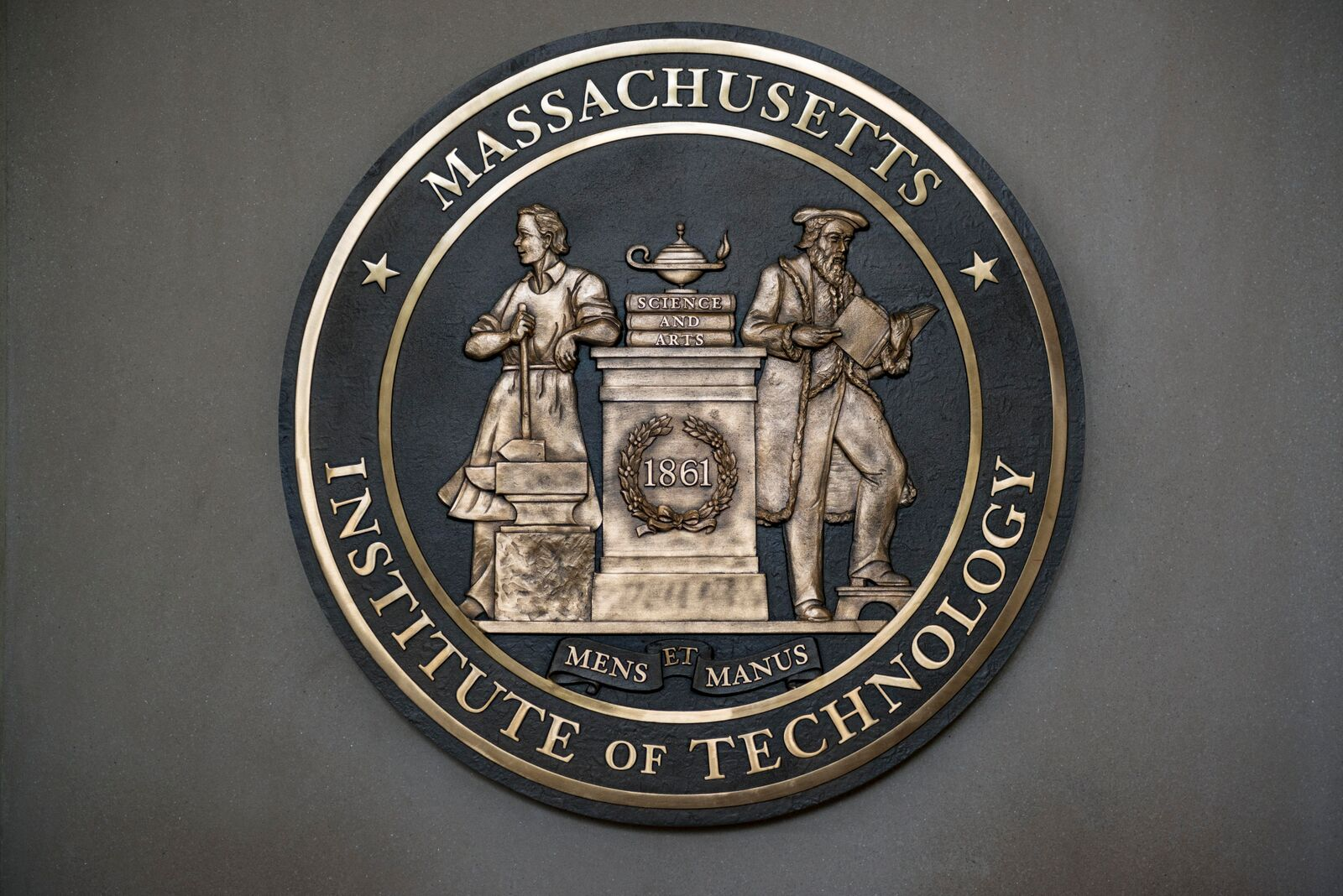 "MIT's motto is ""mens et manus,"" or ""mind and hand,"" signifying the fusion of academic knowledge with practical purpose."
