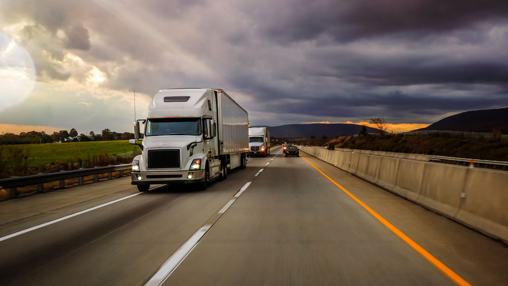 An Image Of 18 Wheeler Driving On The Road